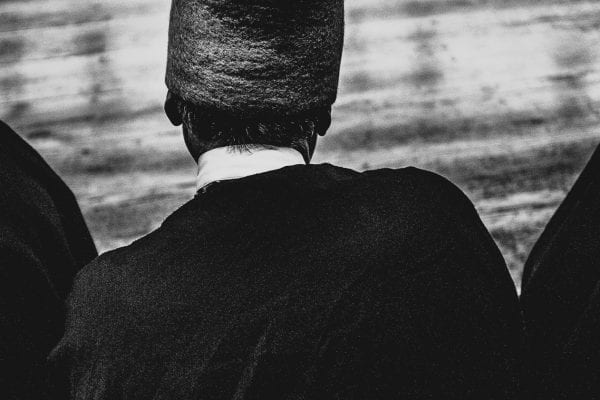 man wearing hat black and white photography with high contrast and flash by francesco merlini