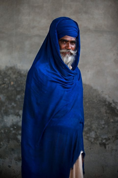 sikh religious man colorful and high contrast portrait photography by mattia passarani