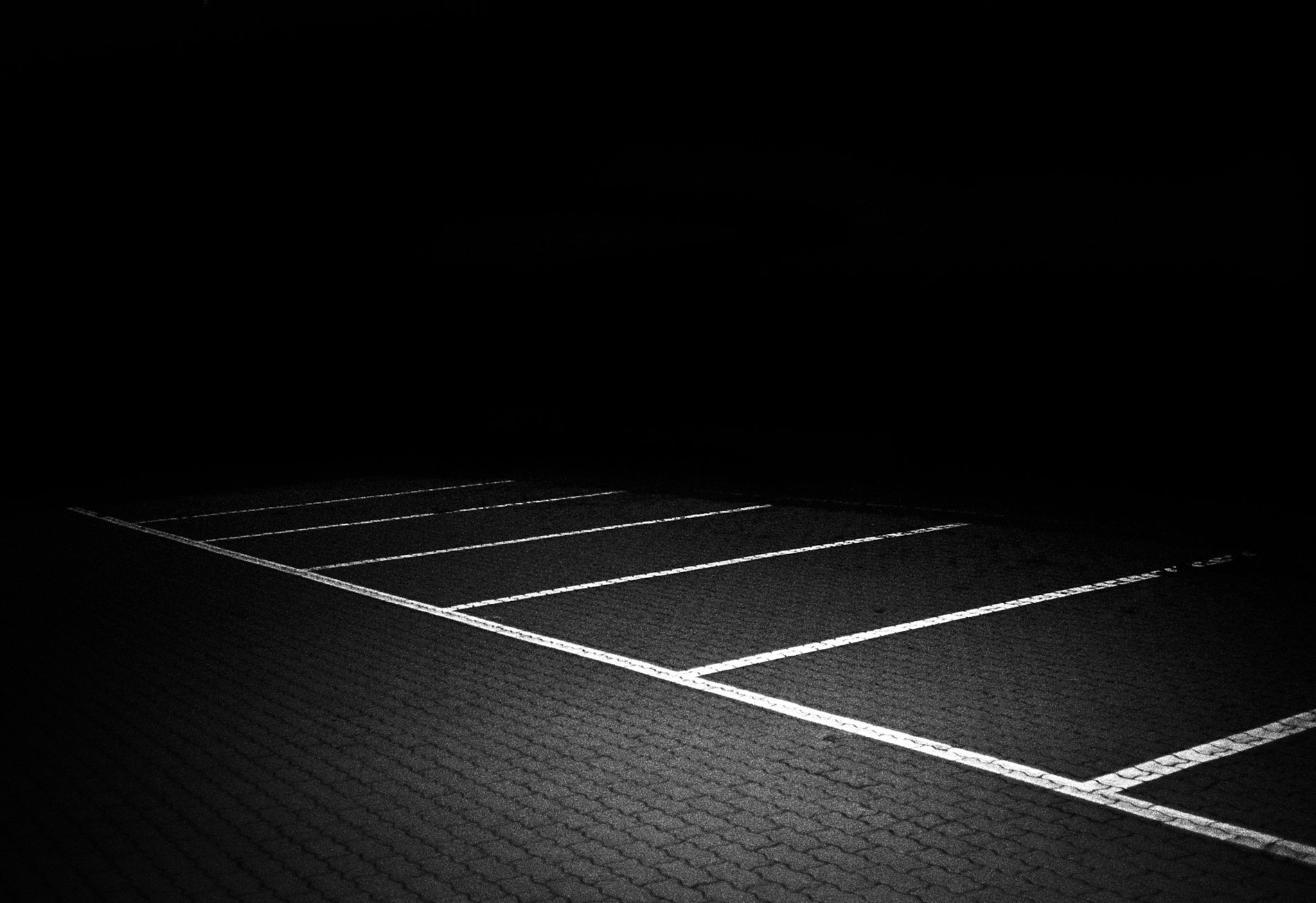 parking lot black and white photography, shallow depth of field, high contrast, by Francesco Merlini
