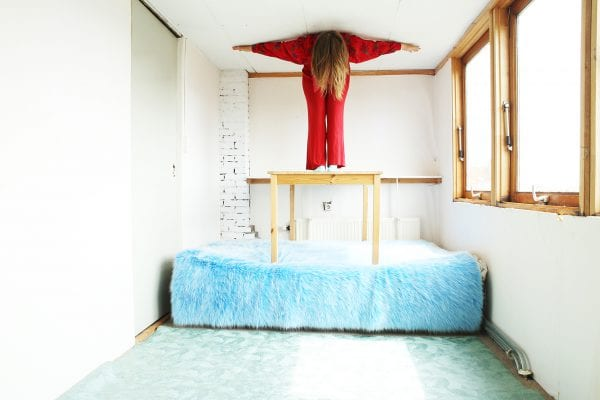woman on blue bed color photography by inge van heerde