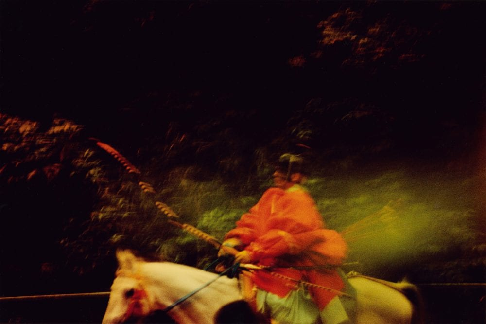 person on a white horse from the sunlanders series, color darkroom prints handmade by Sean Lotman