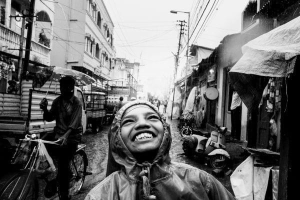 kid smiling, black and white portrait street photography by swarat ghosh