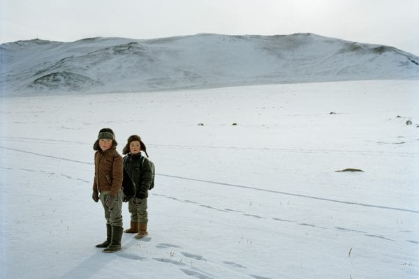 two kids in the snow color and landscape photography in Mongolia