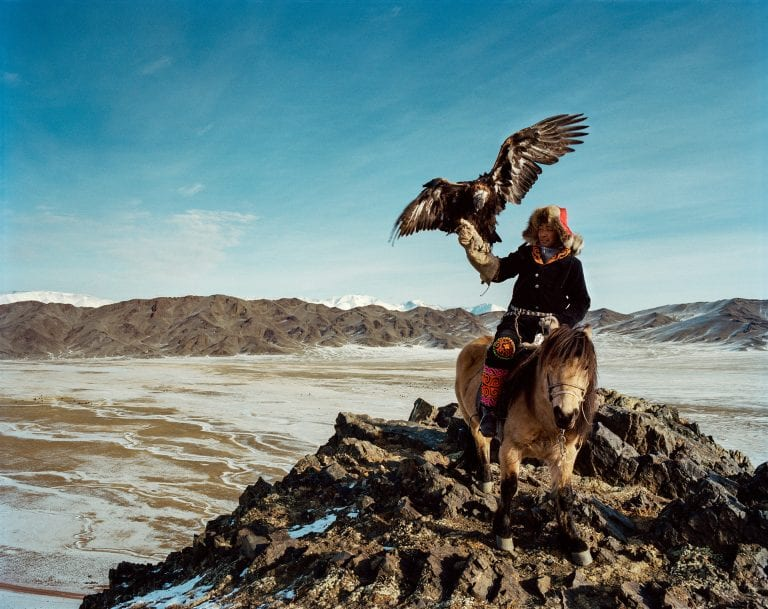 man holding an eagle color and landscape photography in Mongolia