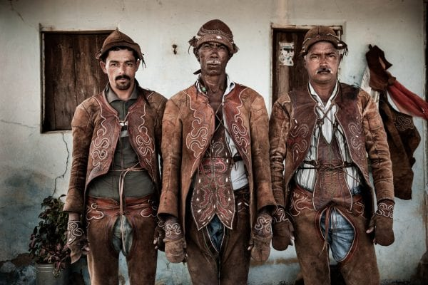 portrait color photo of cowboys from south america