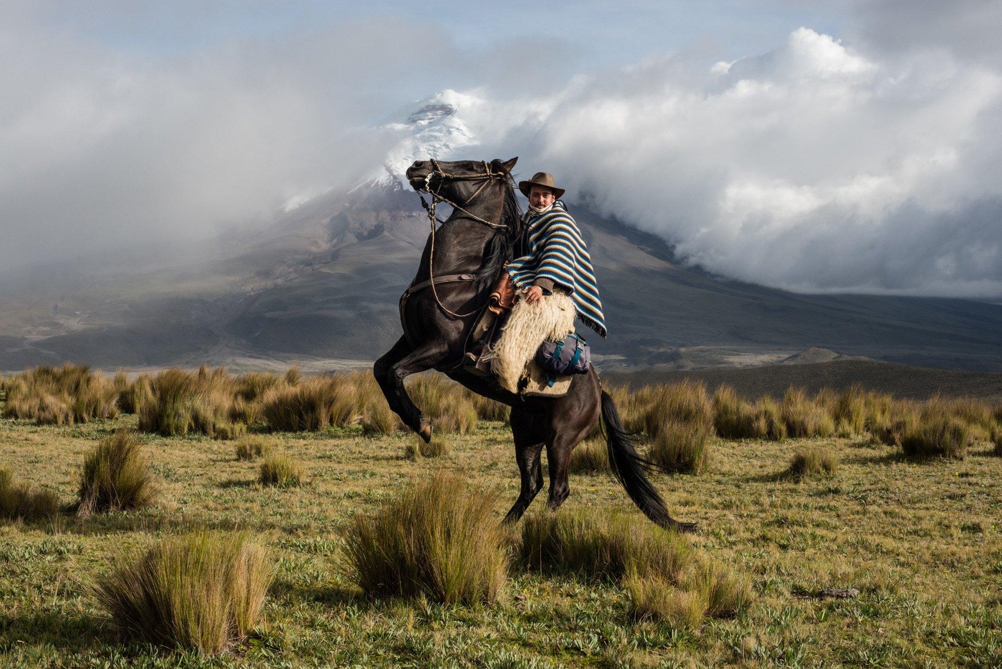 color photograph of a cowboy riding his horse