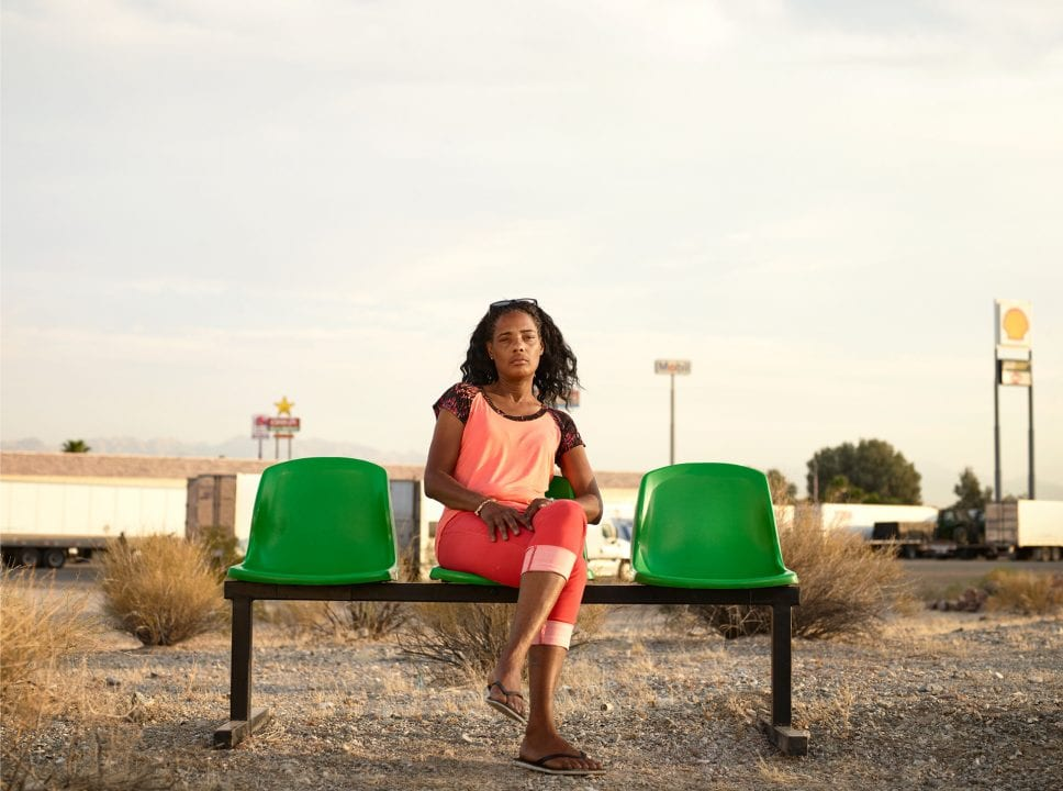 woman sitting on a green bench, color portrait photography by dylan collard