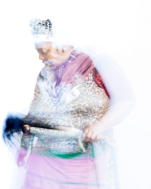 out of focus, blurry, colorful and very contrasted portrait of a healer from South Africa by Thom Pierce