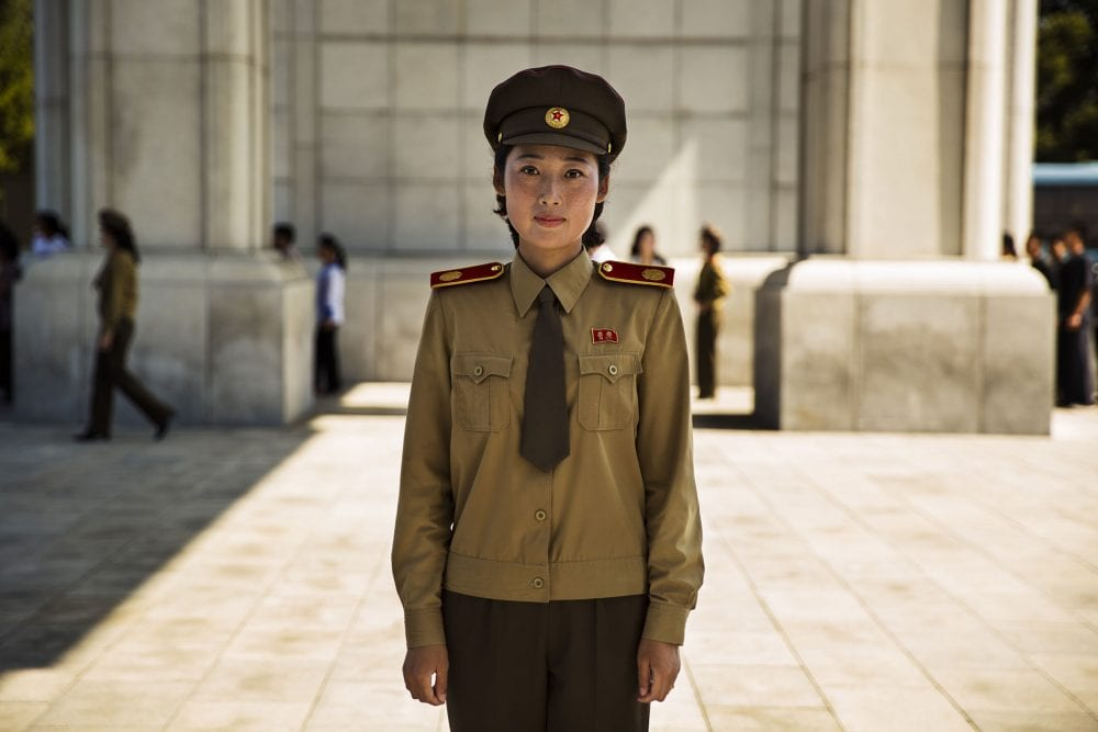 north korea guard woman portrait photography in color by mihaela noroc, the atlas of beauty series