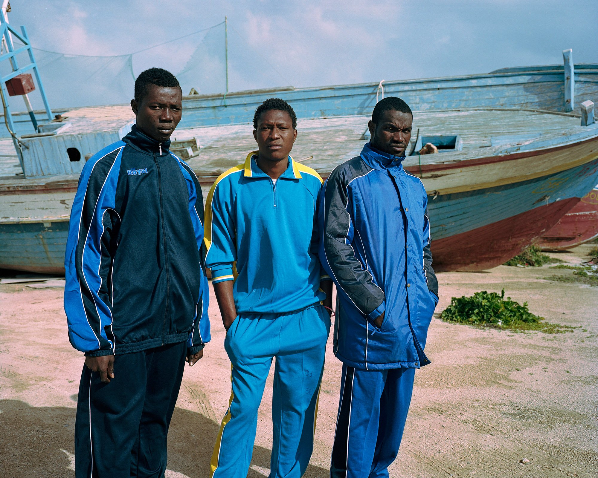 three man wearing blue clothes photography of the migration into Europe in 2015 2016