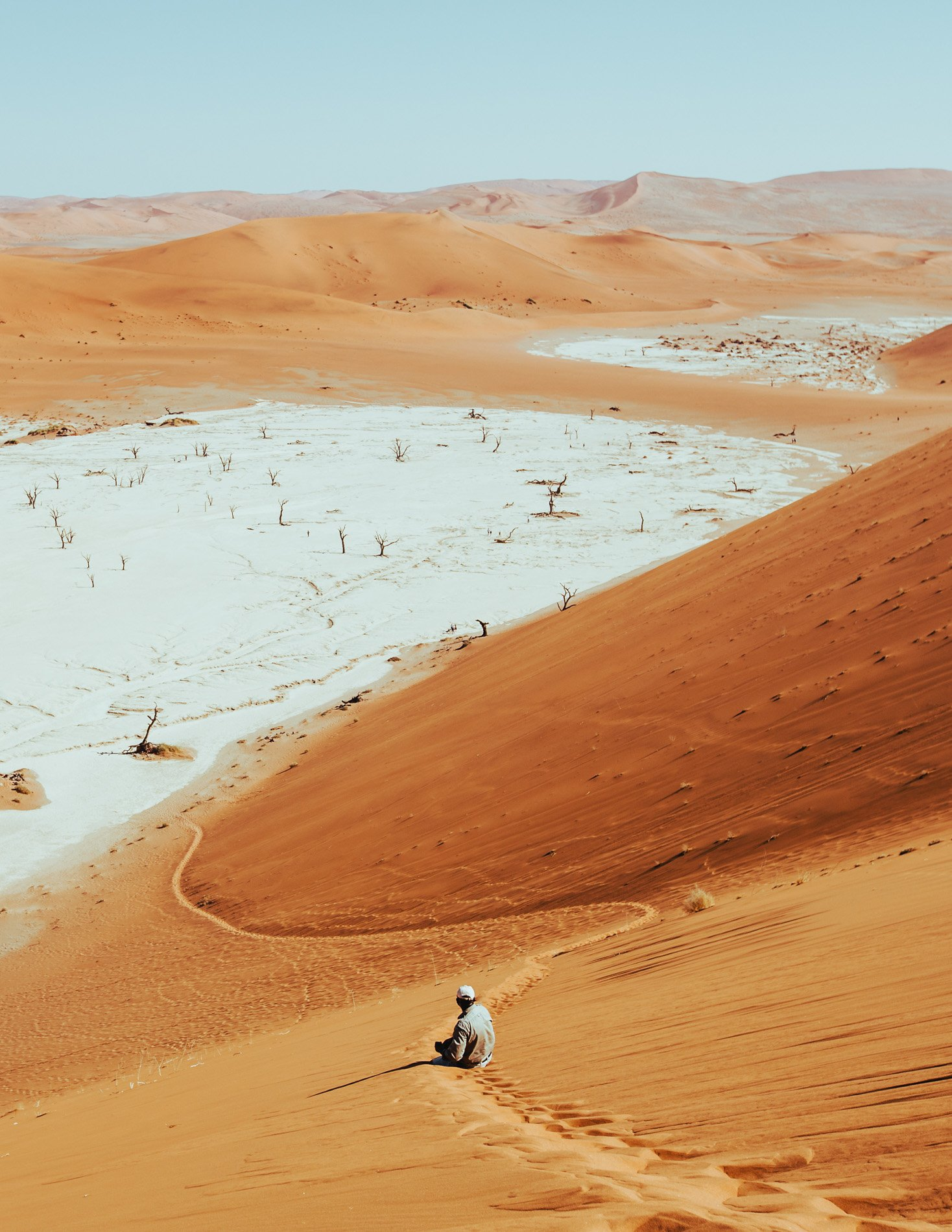 red sand dunes on a landscape photograph by Andrew ross