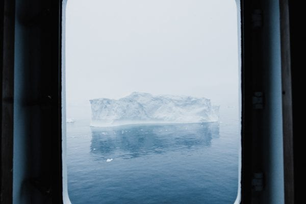 an iceberg from a window on a landscape photograph by Andrew ross