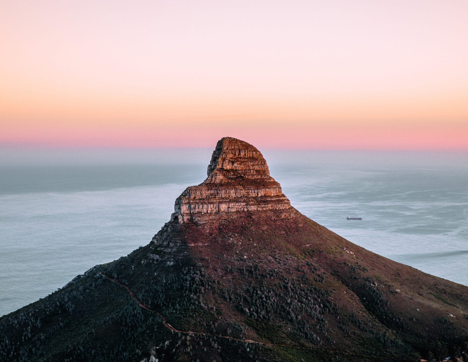 the top a a mountain on a landscape photograph by Andrew ross