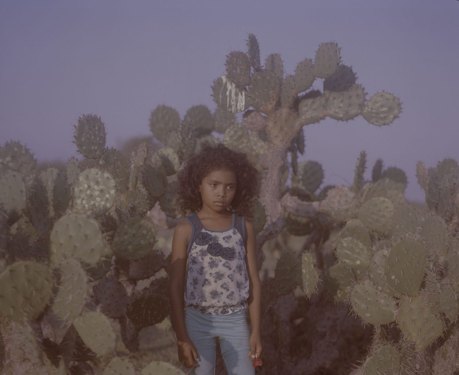 girl and cactus long-term photo project, focusing on the African Identity within Afro-communities in the Americas and Europe, on Costa Chica