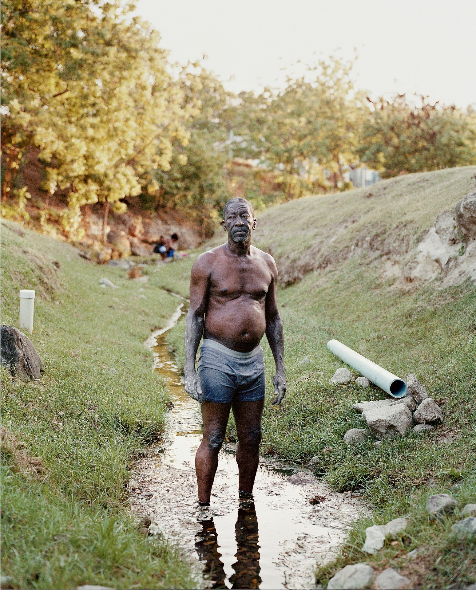 man working color portrait photography in the Caribbean island of Nevis, by Catherine Hyland