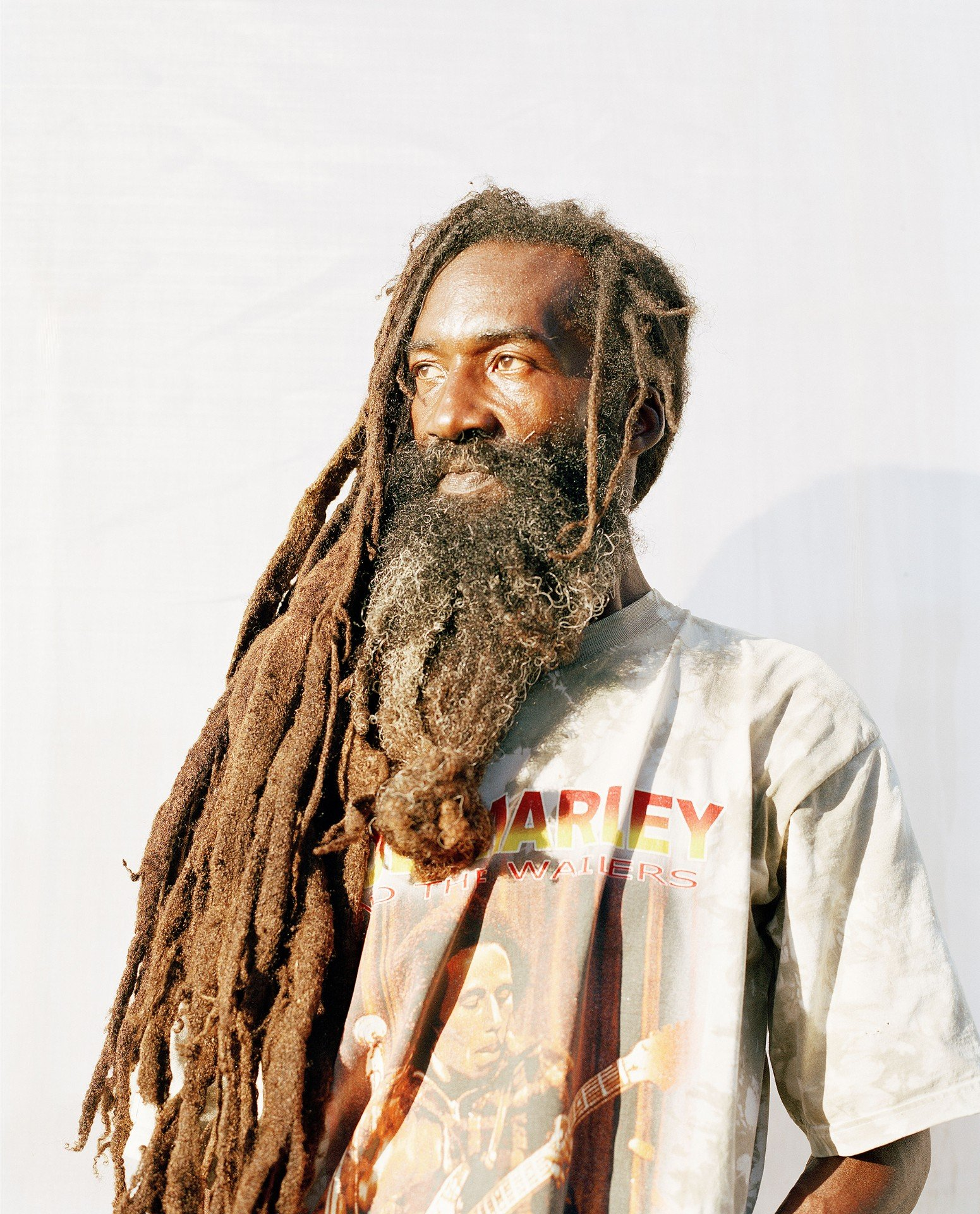 man with long hair color portrait photography in the Caribbean island of Nevis, by Catherine Hyland