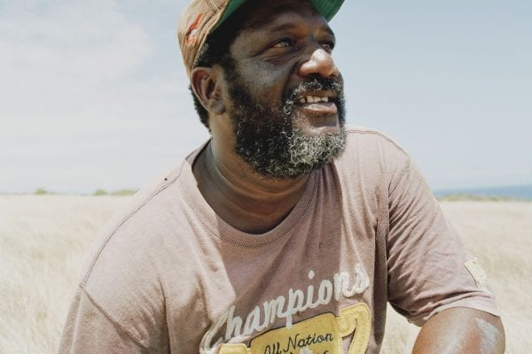 man wearing hat color portrait photography in the Caribbean island of Nevis, by Catherine Hyland