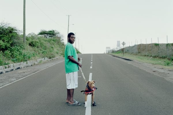 man and his dog color portrait photography in the Caribbean island of Nevis, by Catherine Hyland