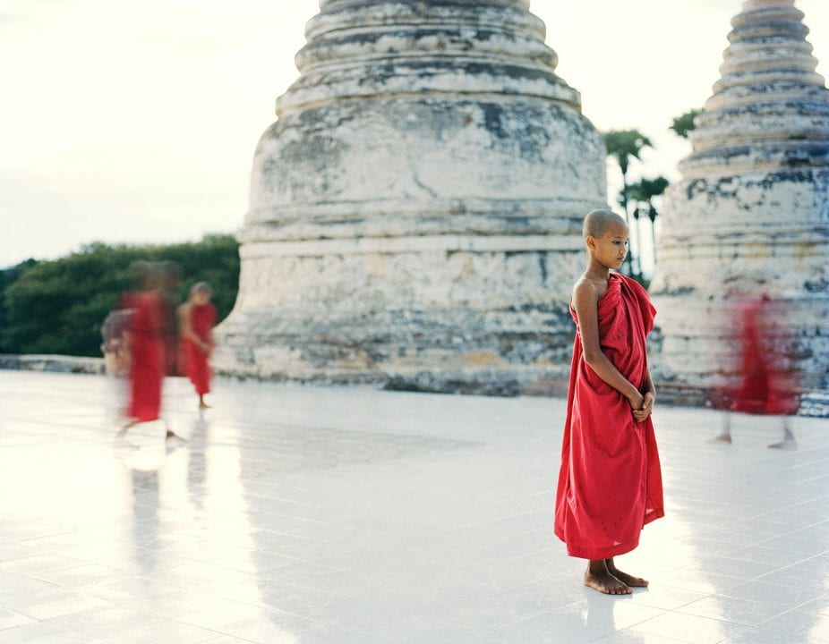 man wearing red color photography in Myanmar by Frédéric Lagrange