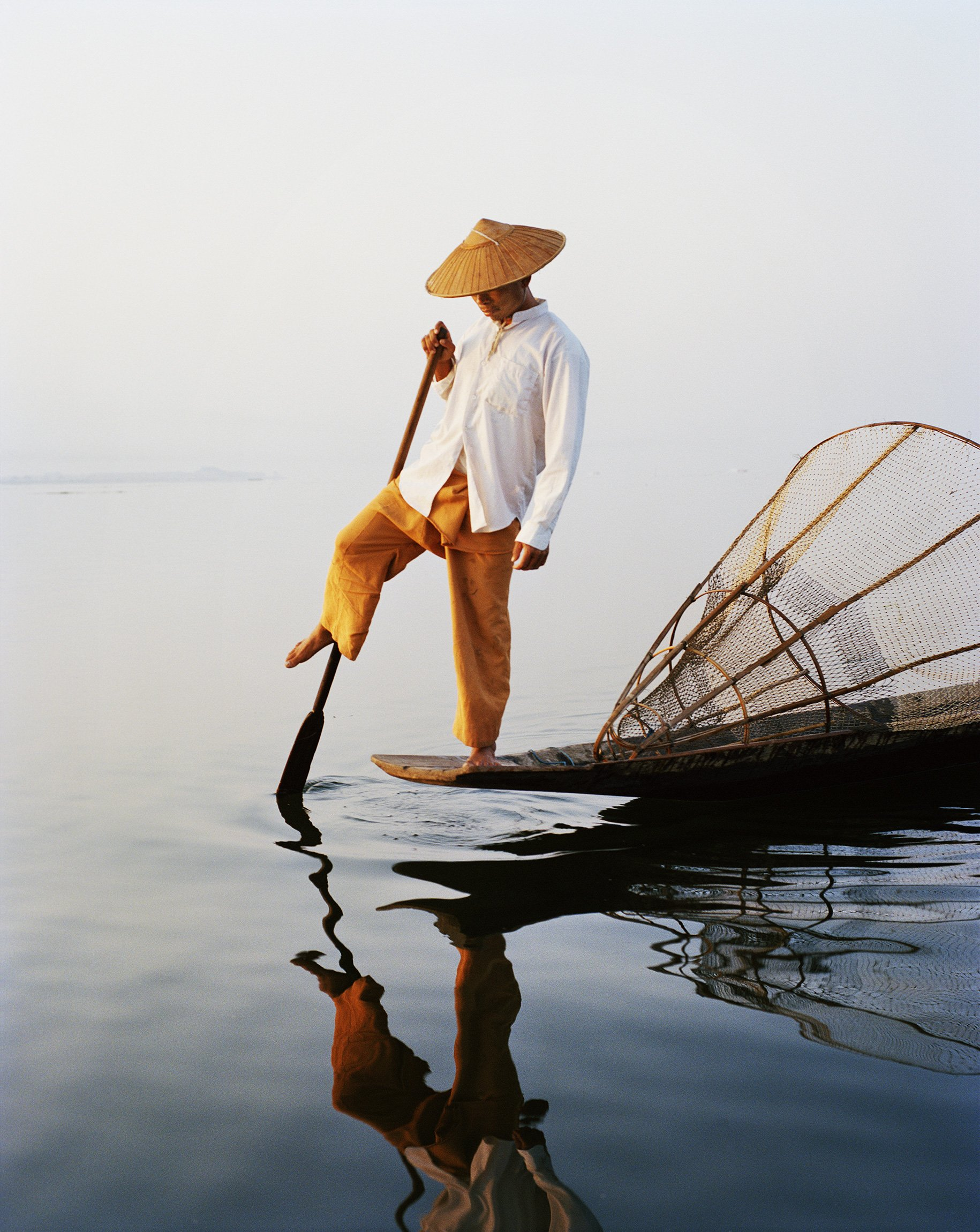 fisherman standing color photography in Myanmar by Frédéric Lagrange