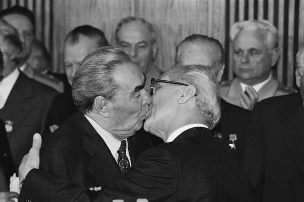 Brezhnev and Erich Honecker performing the 'soviet kiss' or 'fraternal kiss' 1979 Régis Bossu