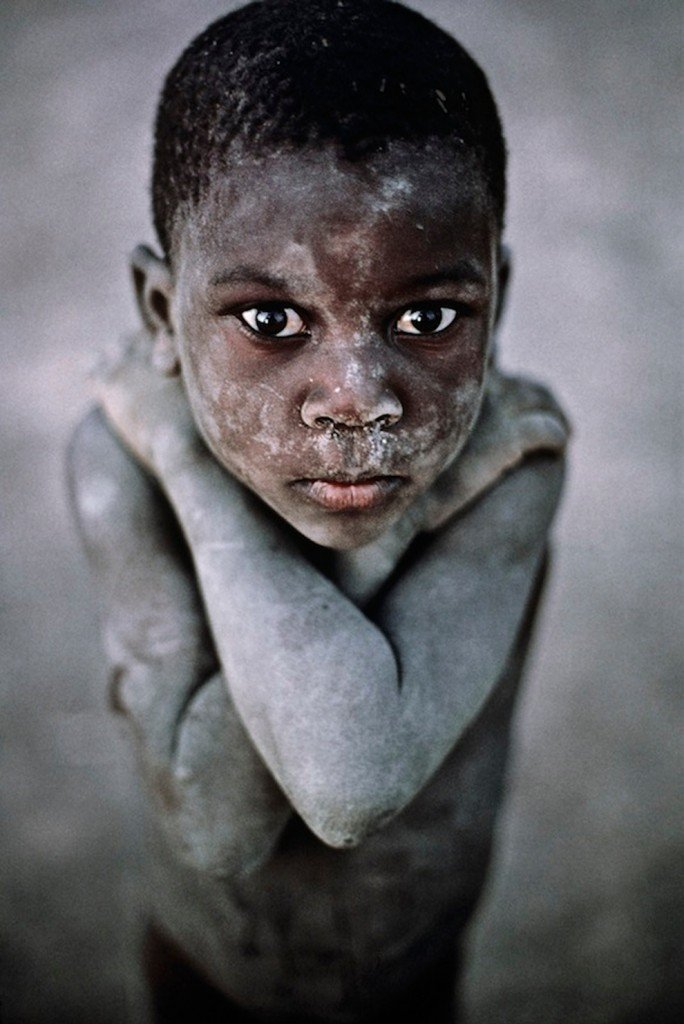 Kid looking into camera by Steve McCurry Timbuktu, Mali, 1987 Color Photography