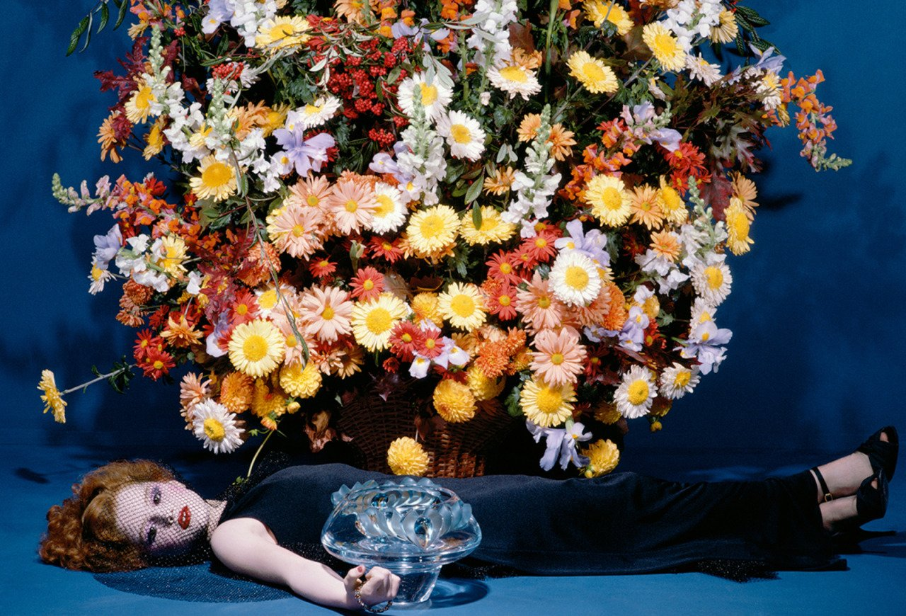 Woman with flowers Color Photography by Guy Bourdin