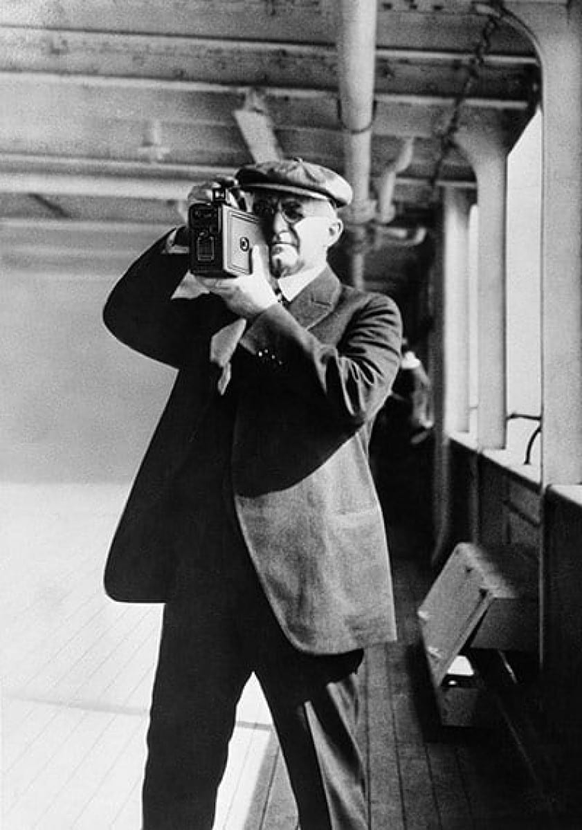 George Eastman taking pictures with a Kodak camera, 1925