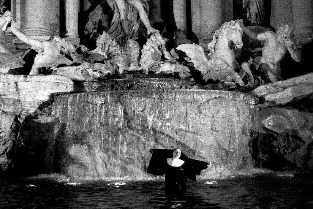 Black And White Photography by Ferdinando Scianna - Nun in Fontana di Trevi, Rome, Italy 2000