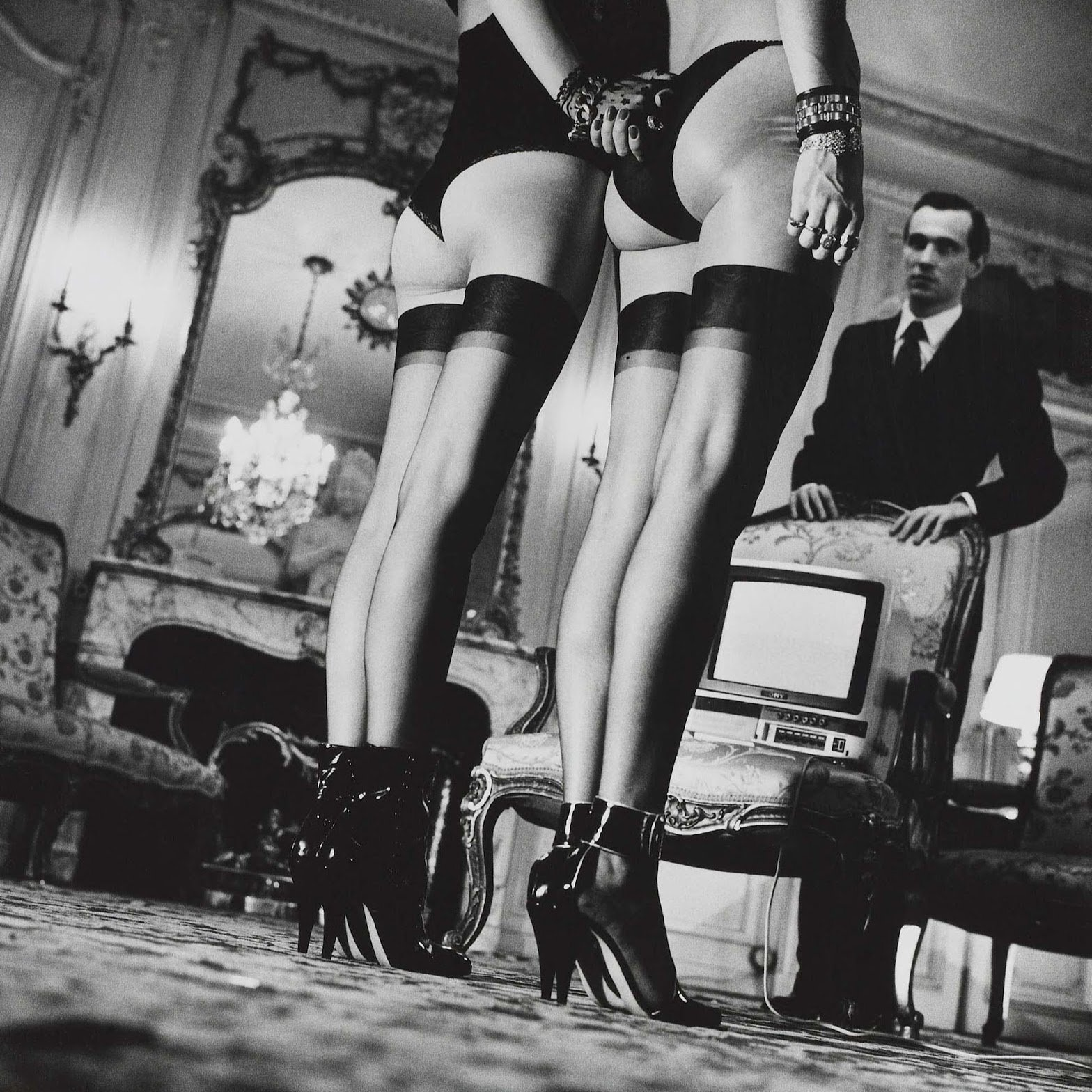 Shot on Hasselblad: Two pairs of legs in black stockings, Paris 1979 © Helmut Newton