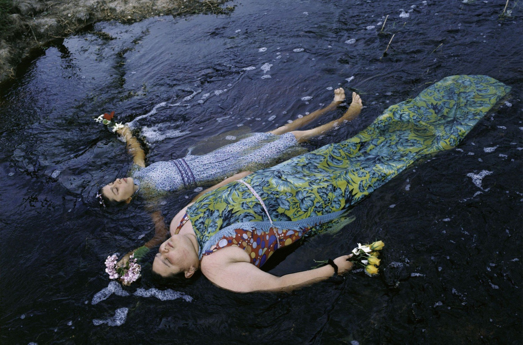 Kids swimming on a river, Buenos Aires, Argentina, 2001 by photographer Alessandra Sanguinetti