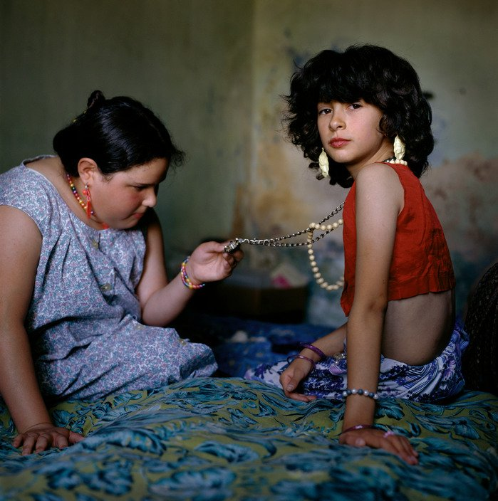 Two girls with necklace, Buenos Aires, Argentina, 1999 by photographer Alessandra Sanguinetti