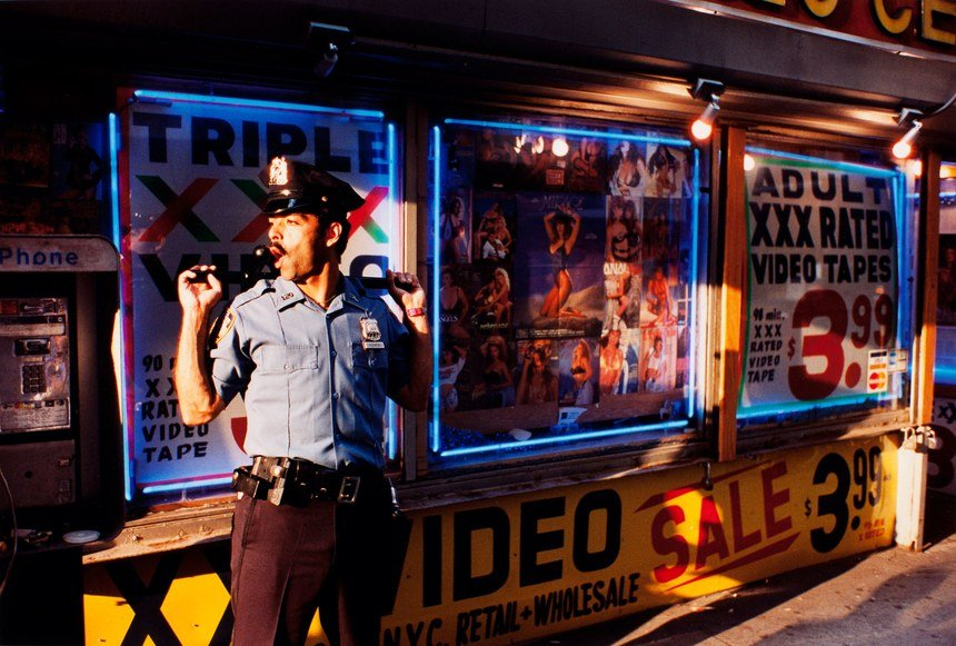 Policeman, color street photography in NYC (from Sidewalk) © Jeff Mermelstein