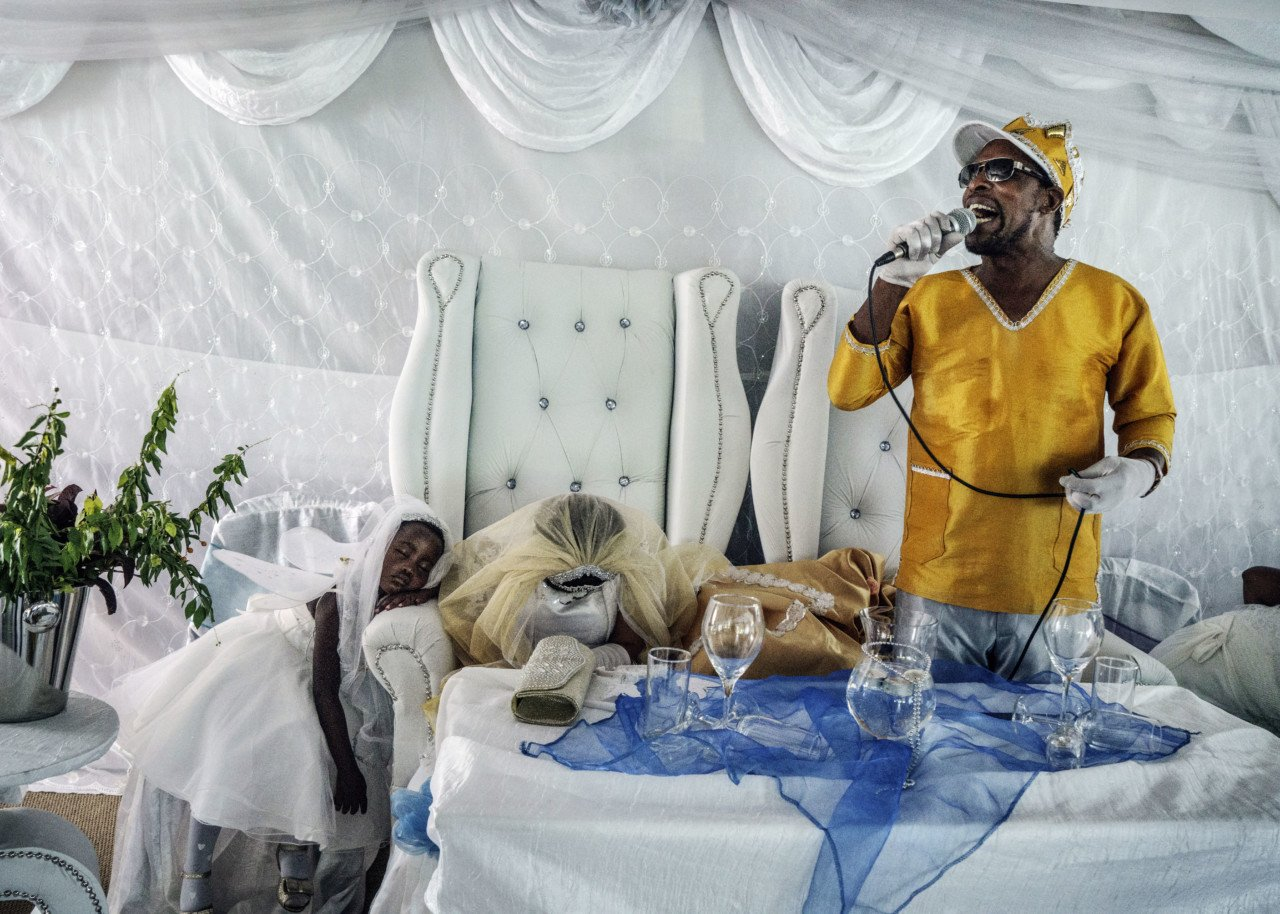 Moses preaches to his flock during the wedding. Moses Hlongwane is known to his thirty or so disciples in South Africa as The King of Kings, The Lord of Lords, or simply: Jesus.