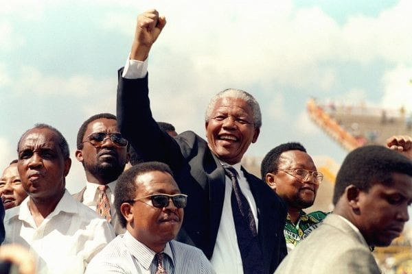 Nelson Mandela arrives for his first election rally, Mmabatho, March 15, 1994