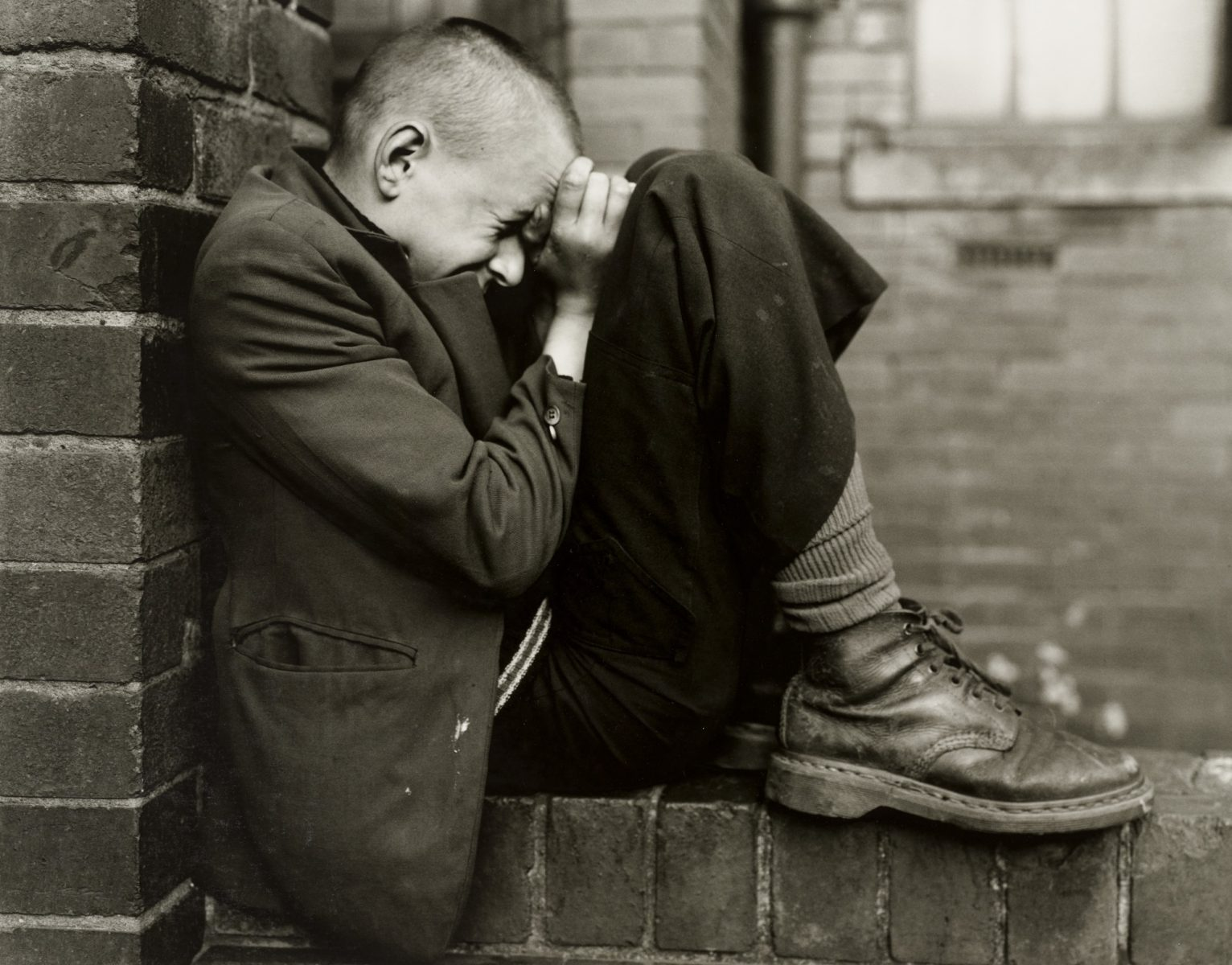 Youth on wall, Jarrow, Tyneside, UK, 1976 by Chris Killip - Photography and solitude