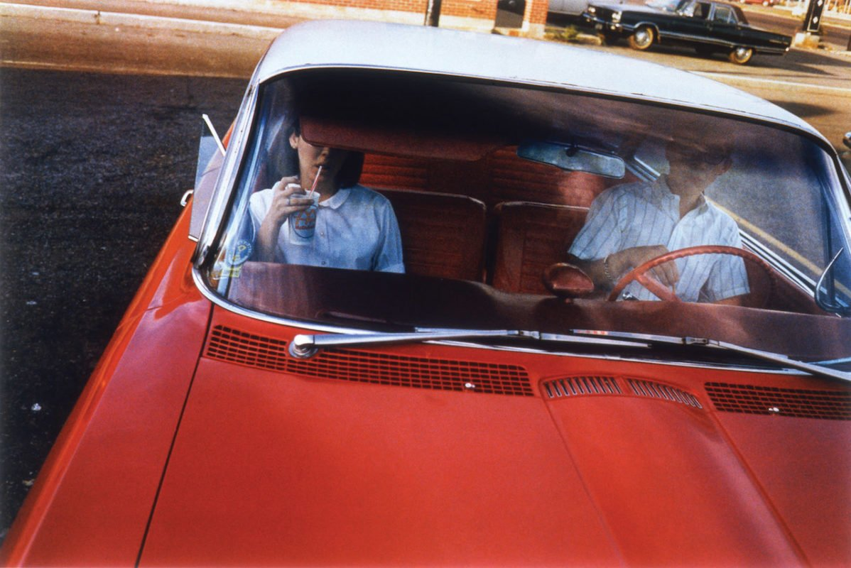 Color Photography of a Man drinking in a red car William Eggleston Los Alamos Book Photography
