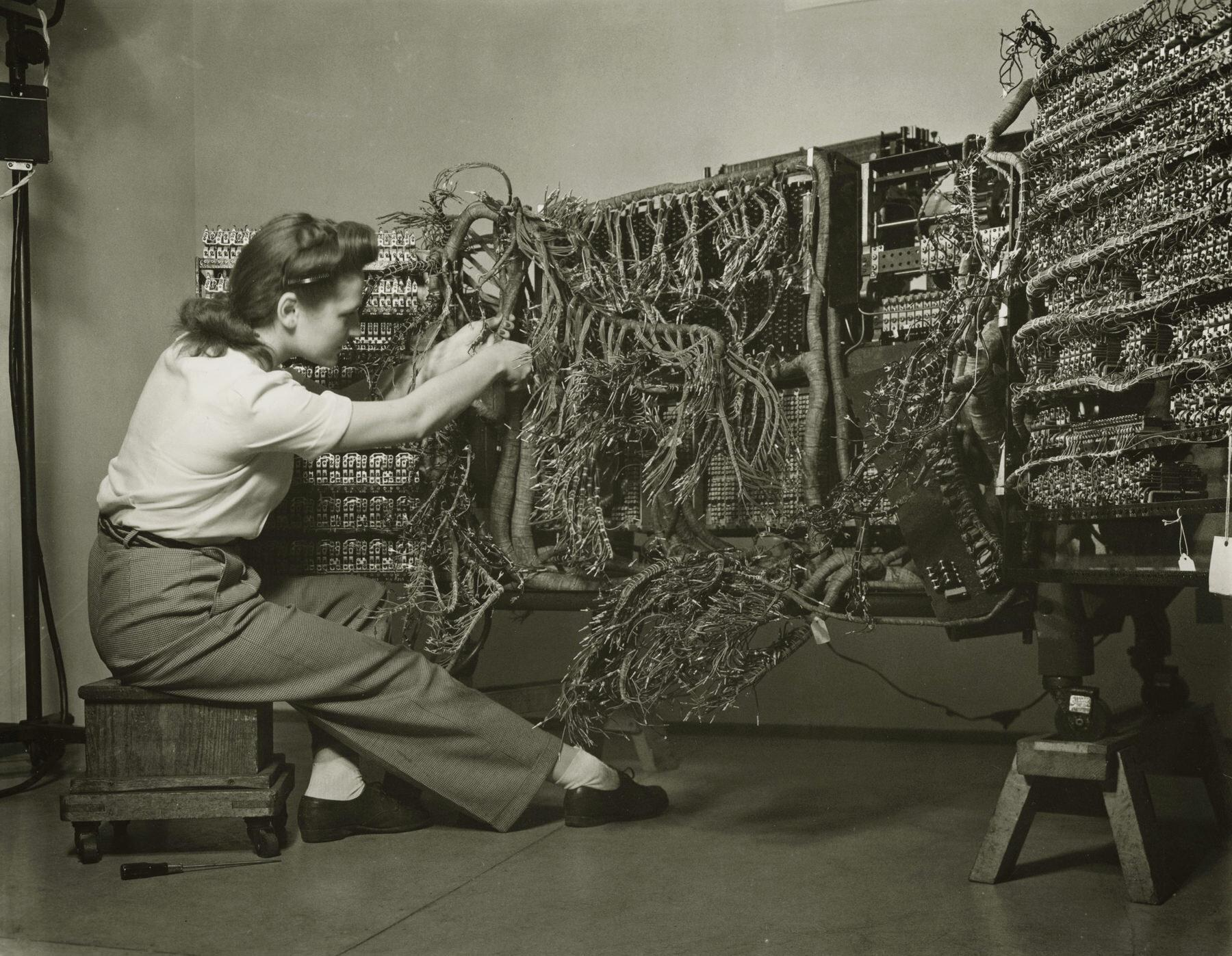 Woman wiring an early IBM computer, from the documenting science series, 1958 © Berenice Abbott Legendary Women in Photography