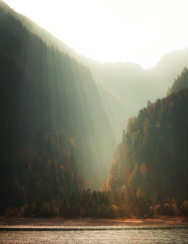 Landscape Photography, mountainand sun through valley