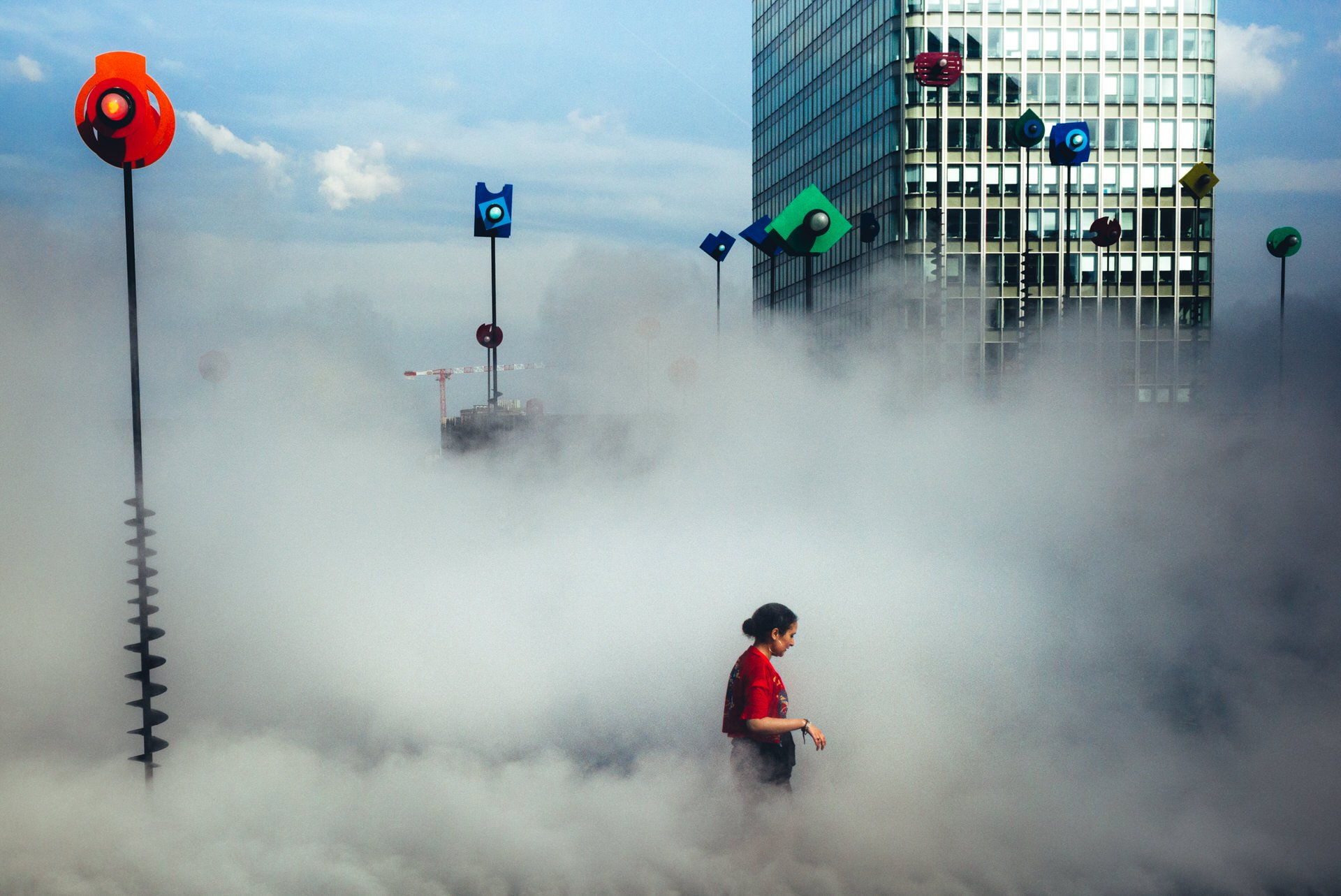 'In the clouds' In Paris, in Le Bassin Takis, a woman takes advantage of the misters. With the heat wave hitting the city, the need for fresh air is felt.