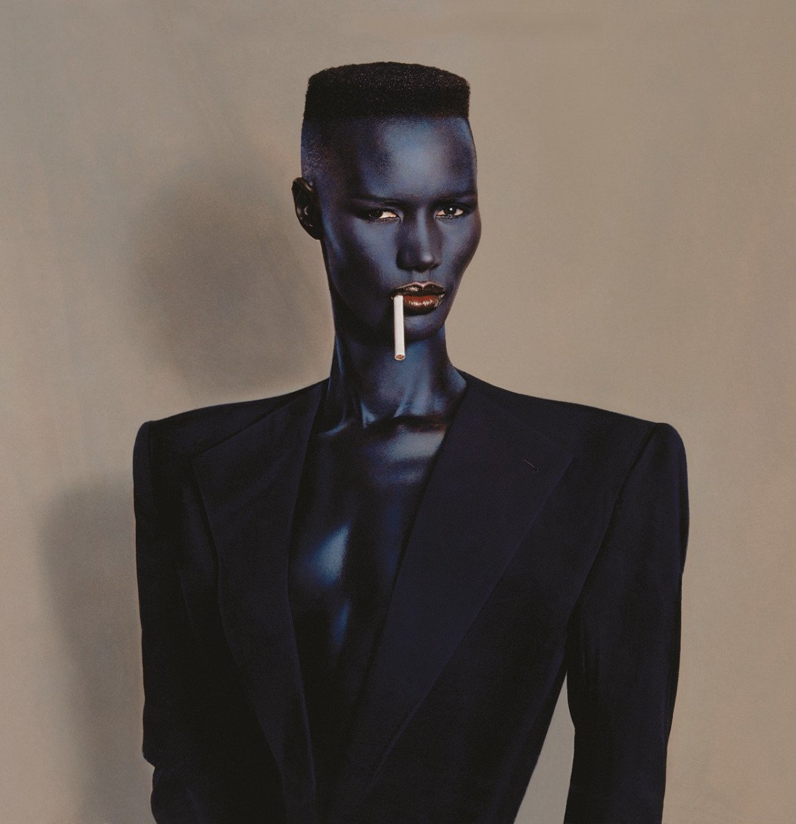 Photography And Music - Grace Jones, blue-black in black on brown, New York, 1981. © Jean-Paul Goude