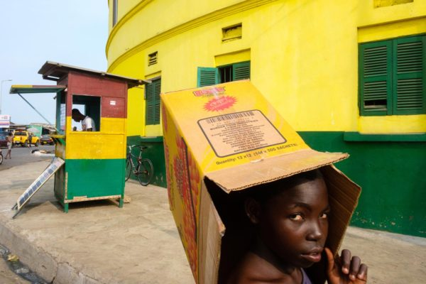 a young girl walking the streets of Accra, Ghana