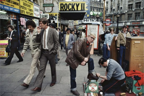 William Klein - Shoe polisher, Rocky II, etc. London 1981