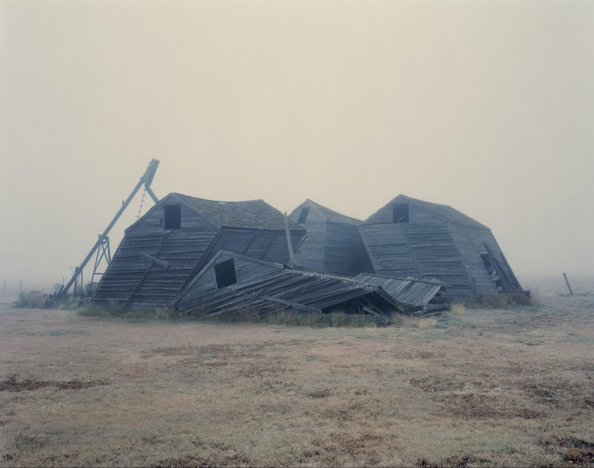Crumpled Barns, Texas, 1995 photograph by Nadav Kander