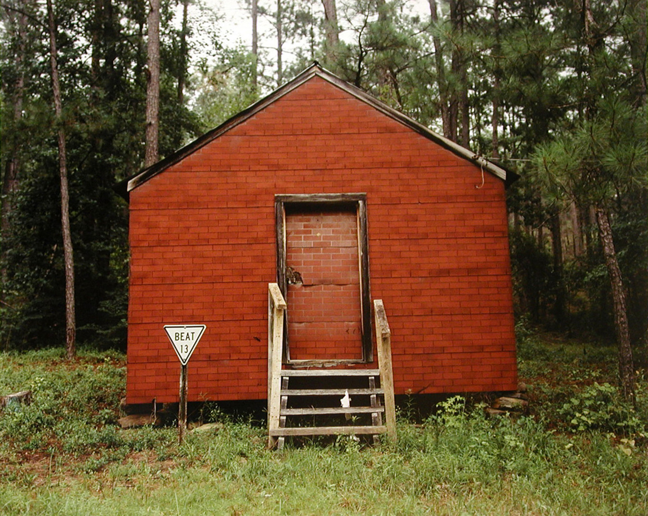 Color photography, Red Building in Forest, Hale County, Alabama, 1974 © William Christenberry