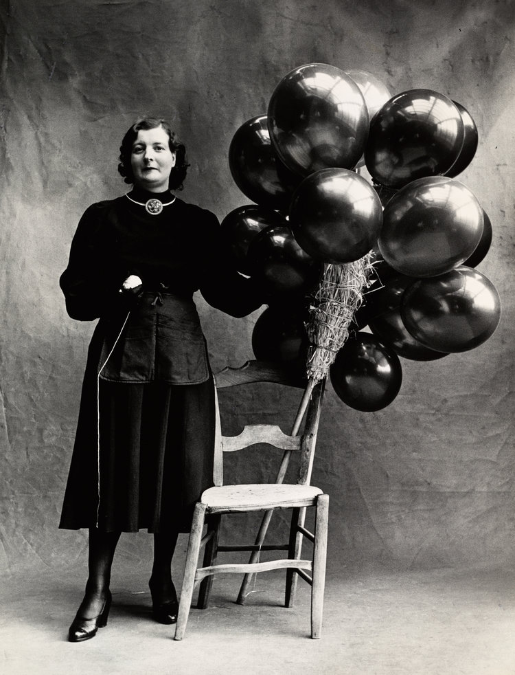 black and white portrait of a French woman with balloons, 1950 © Irving Penn / Condé Nast