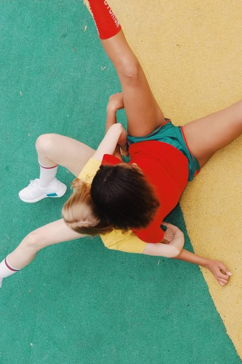 Fashion editorial image of two women weraing colorful sports clothes
