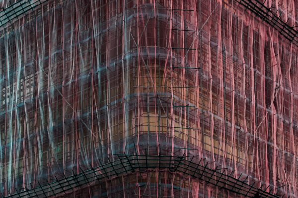 photograph of a bamboo scaffolding cloaking a Hong Kong building by Tom Leighton