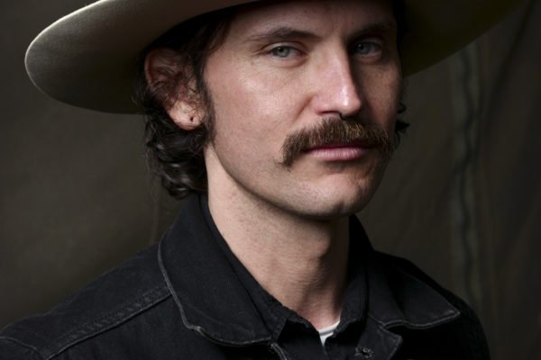 portrait photograph of a man with hat