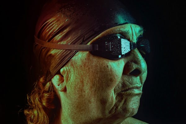 photograph of a woman with swimming goggles